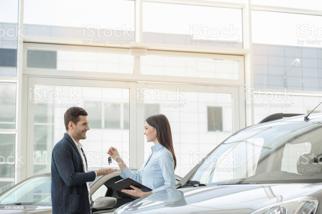 Young People in a Car Rental Service Transportation Concept stock photo