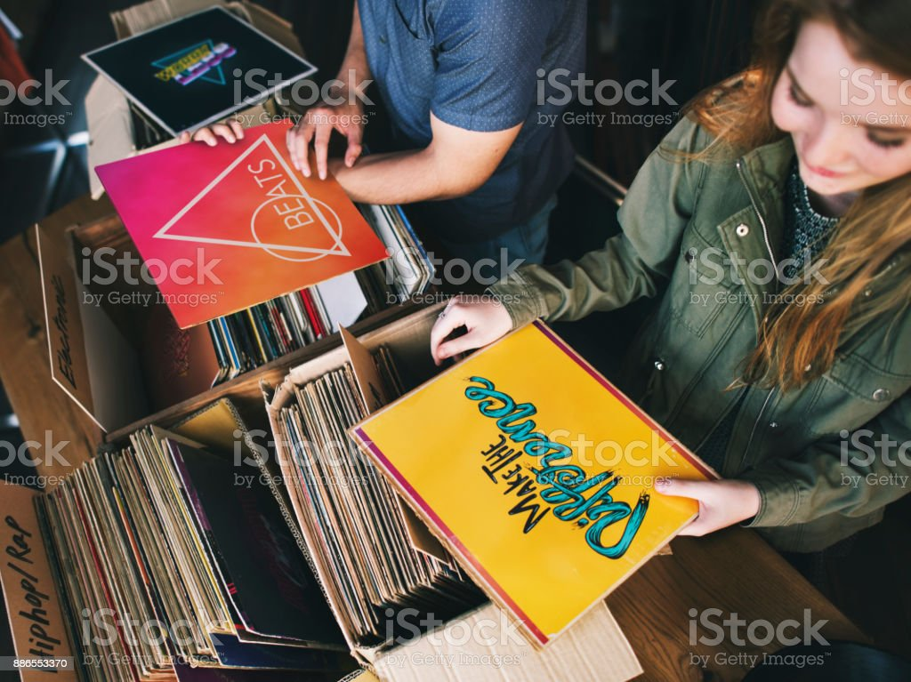 Young people in a record shop stock photo