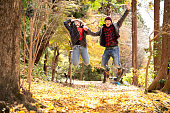 Young people in autumn foliage.