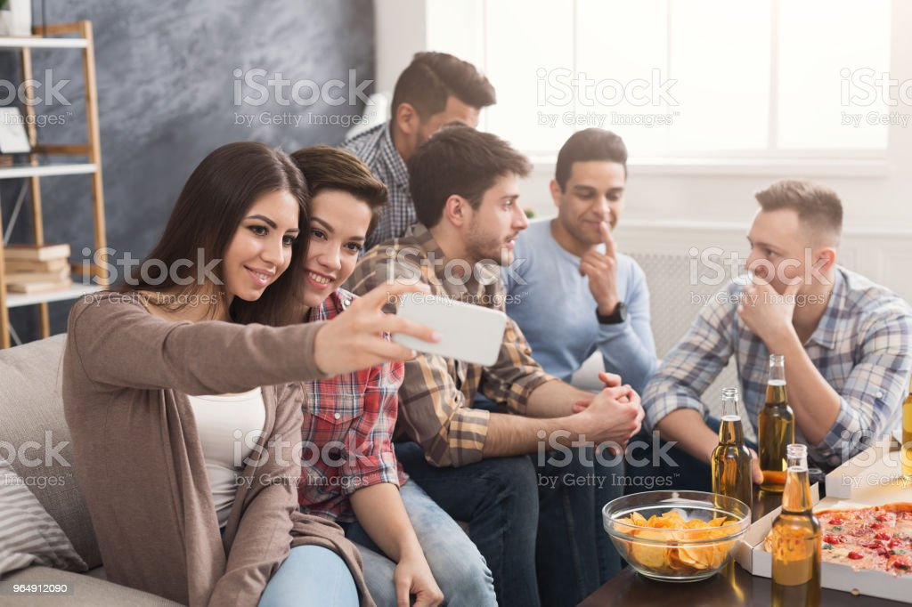 Young people in casual clothes are resting at home royalty-free stock photo