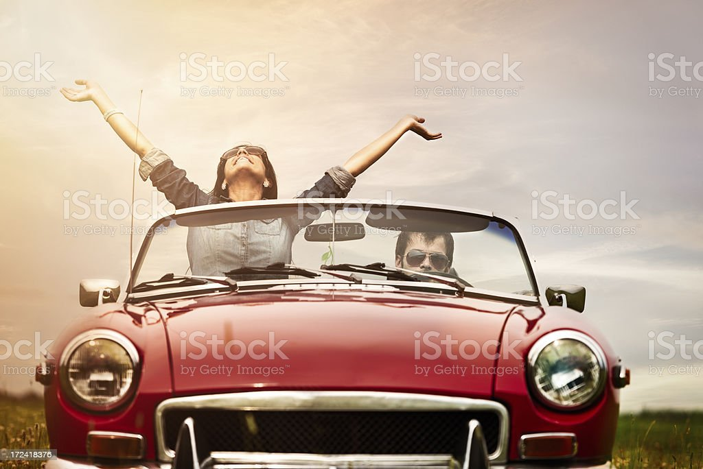 Young people in front seat of cabriolet stock photo