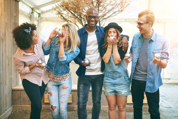 Young people in petanque game center stock photo