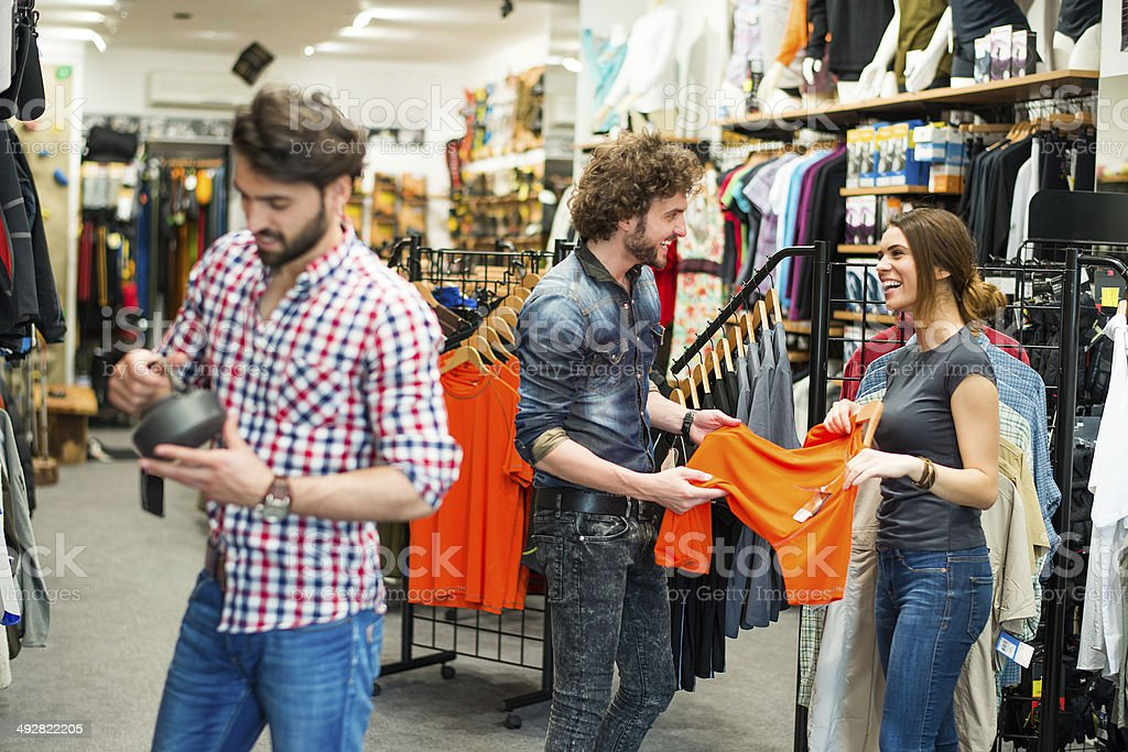 Young people in sports store stock photo