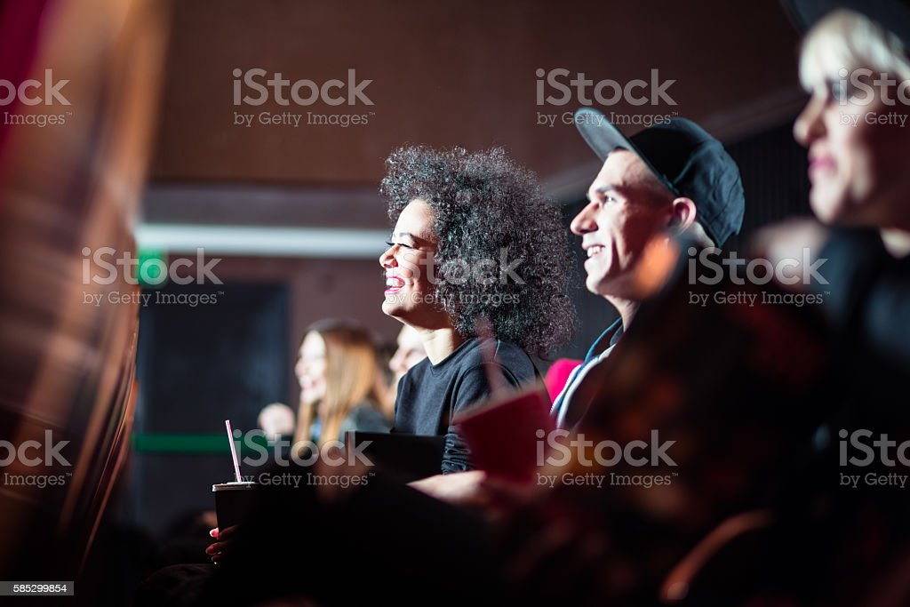 Young people in the cinema stock photo