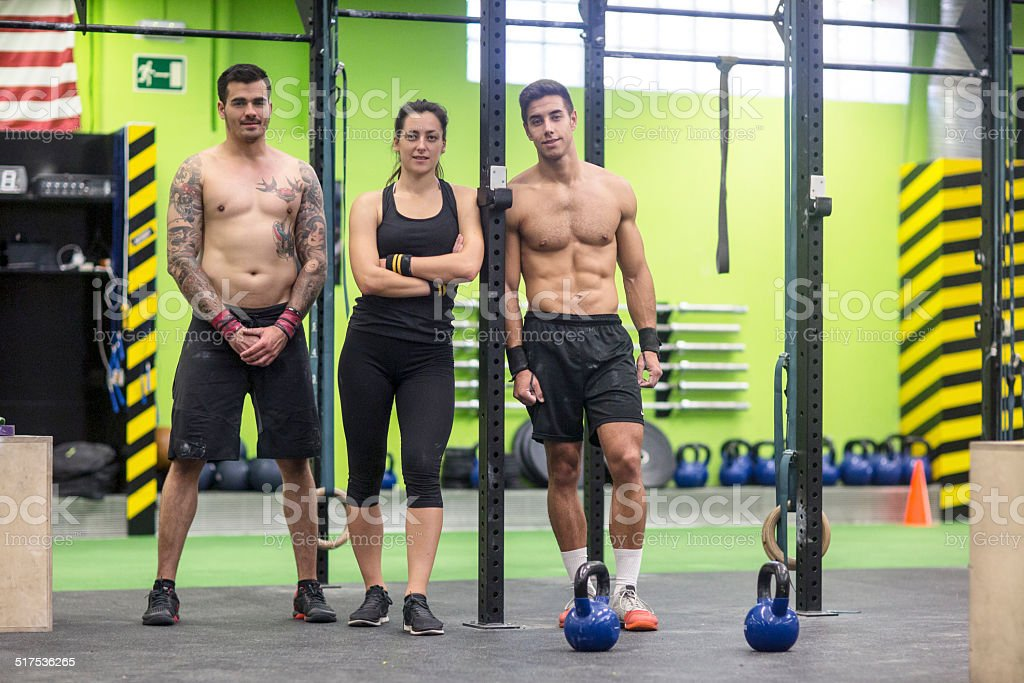 Portrait of three young people at the gym gym.