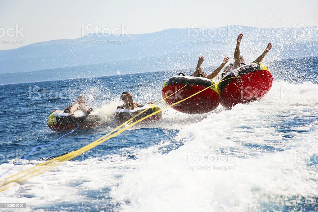 Young people in the water tubing stock photo