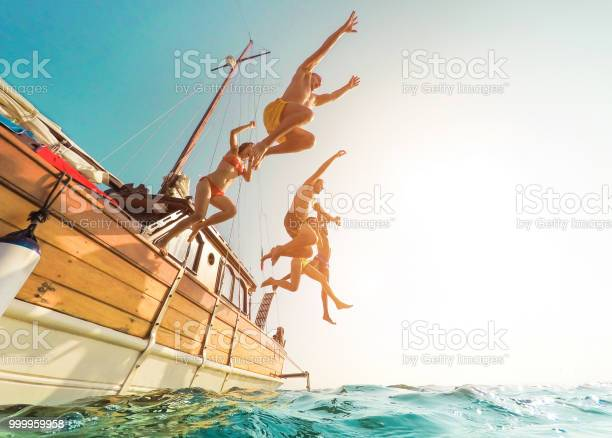 Young people jumping inside ocean in summer excursion day happy picture id999959958?b=1&k=6&m=999959958&s=612x612&h=i1sia6 kfulmtdrvsanwwzzwlqf5me4kniedfnatkti=