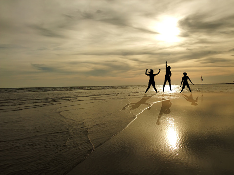 Young People Jumping On The Beach With Sunset Background ...