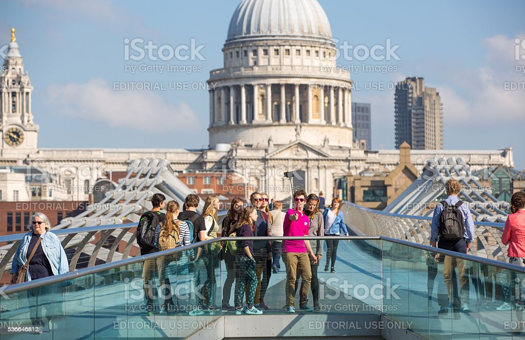 Young people making a selfie at the millennium bridge, London stock photo