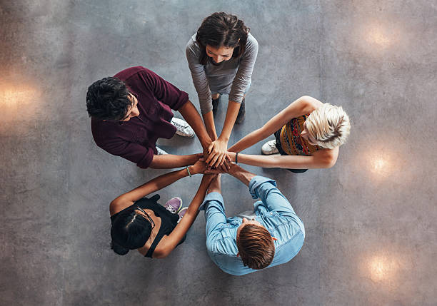 Young people making a stack of hands stock photo