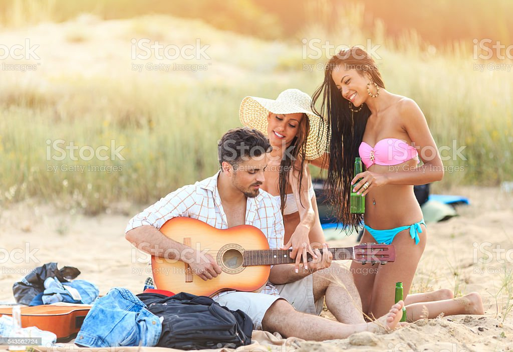 Young people making party on beach stock photo