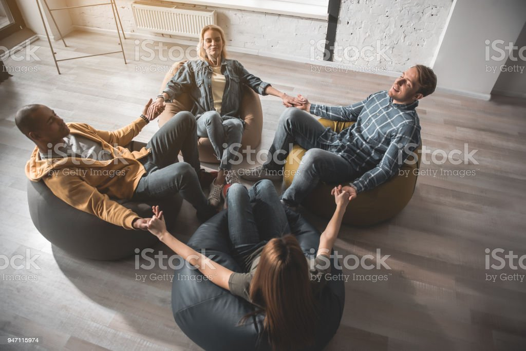 Young people meditating with comfort stock photo