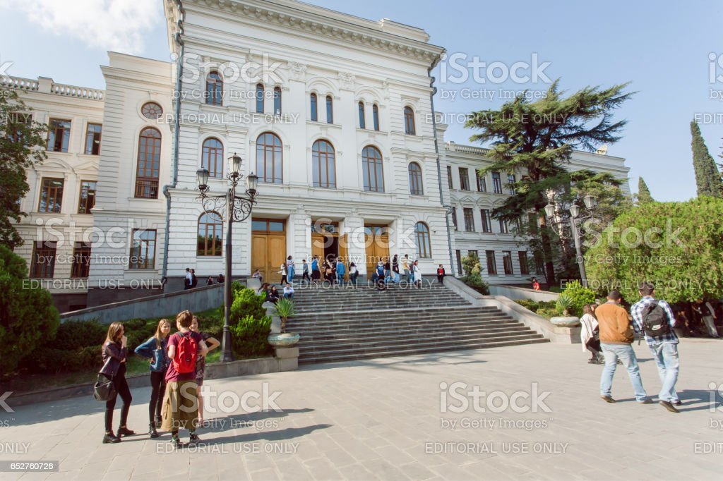 Young people meeting and talking near the Tbilisi State University, established 1918 stock photo