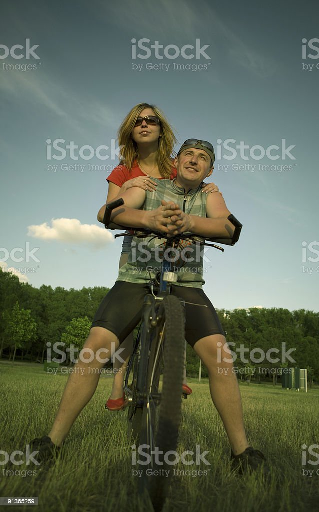 Young people on a bicycle royalty-free stock photo