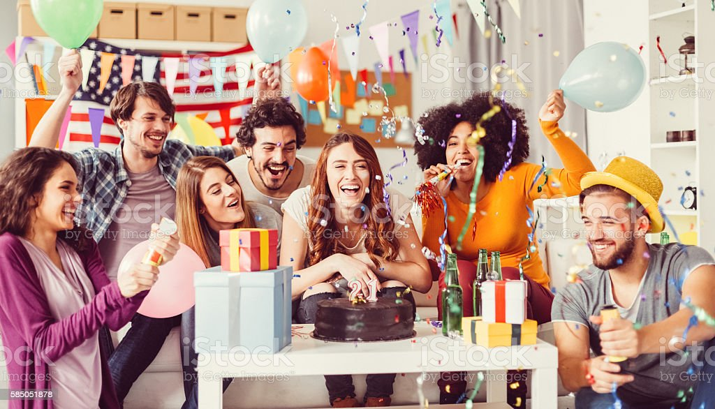 Young People On A Birthday Party In The Office Stock Photo