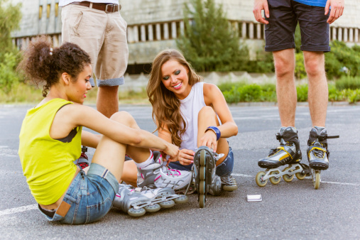 Young People On Rollerblades Stock Photo - Download Image Now