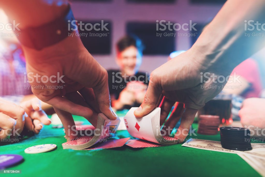 Young people play poker at the table. stock photo