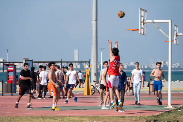Young People Playing Basketball At Park, Mersin, Turkey stock photo