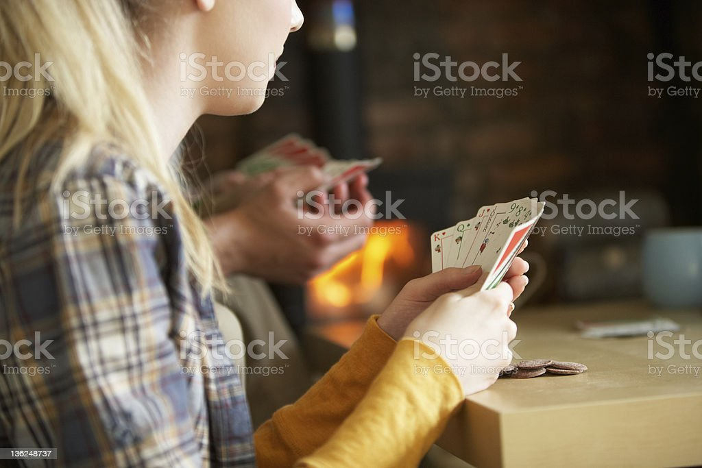 Young people playing cards royalty-free stock photo