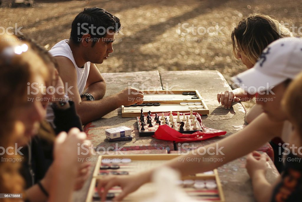Young people playing checkers outdoor royalty-free stock photo