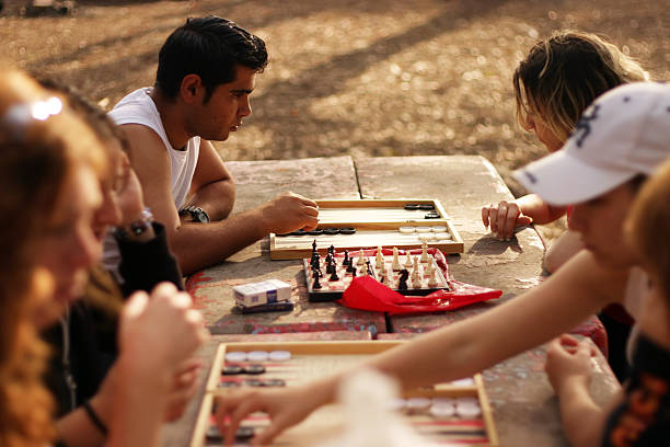young people playing checkers outdoor - backgammon stock pictures, royalty-free photos & images