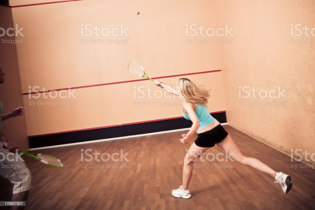 young people playing squash at the gym royalty-free stock photo