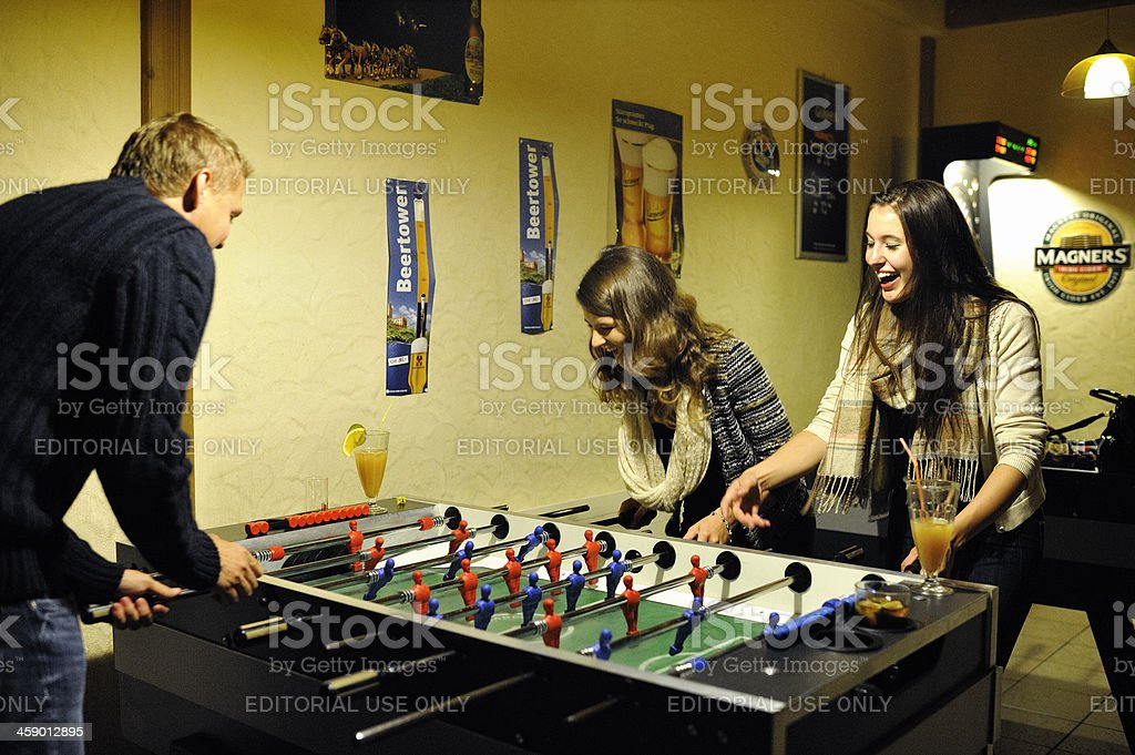Young People Playing Table Football royalty-free stock photo