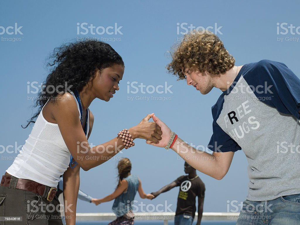Young people playing thumb war 免版稅 stock photo