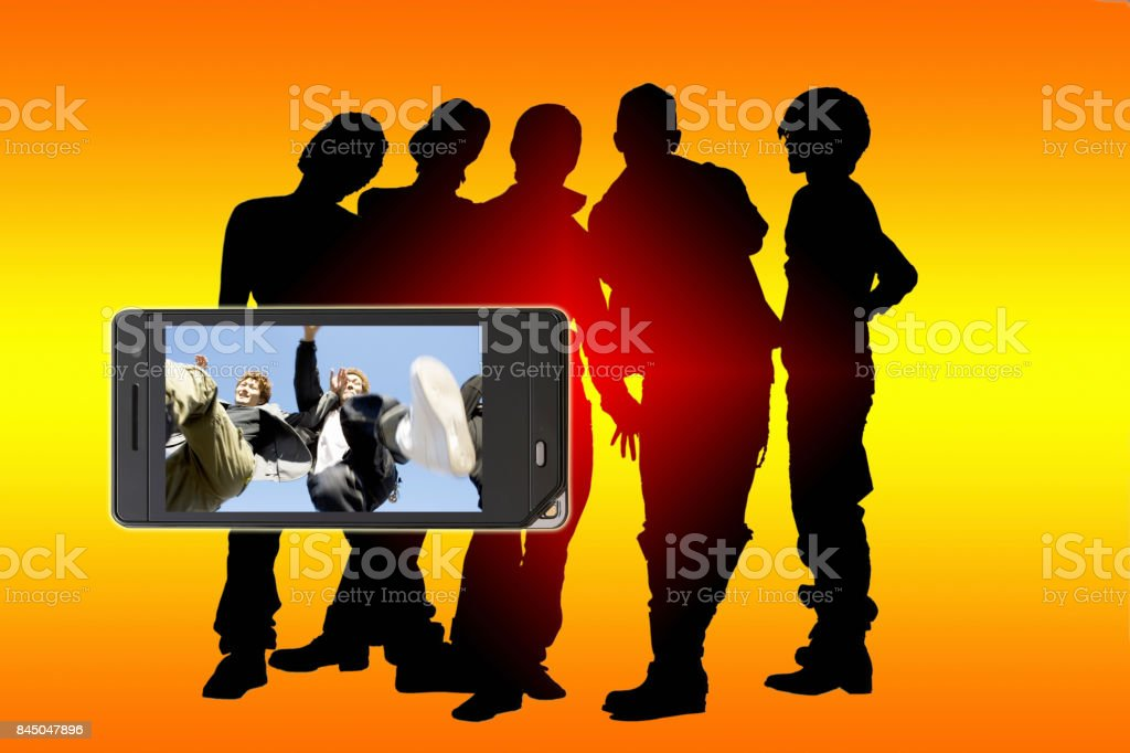 Young people projected to mobile screen with silhouette of a young man stock photo