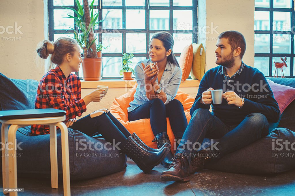 young people relaxing and chatting stock photo
