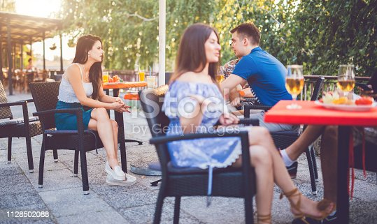 istock Young people relaxing in patio section 1128502088
