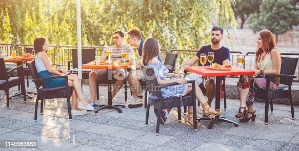 183064447 istock photo Young people relaxing in patio section 1145983683