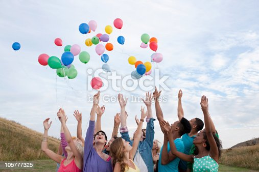 istock Young people releasing balloons 105777325