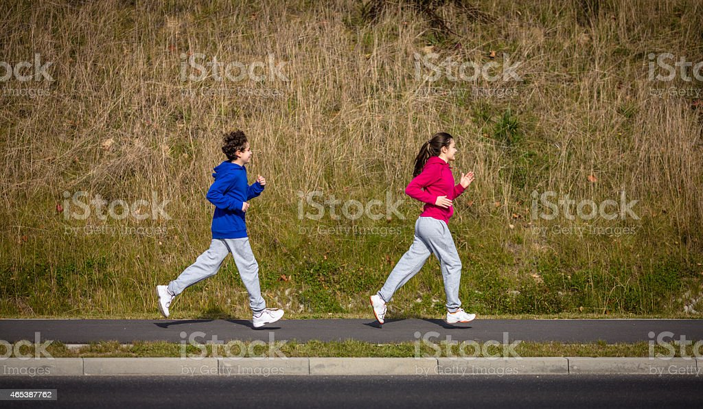Young people running outdoor stock photo