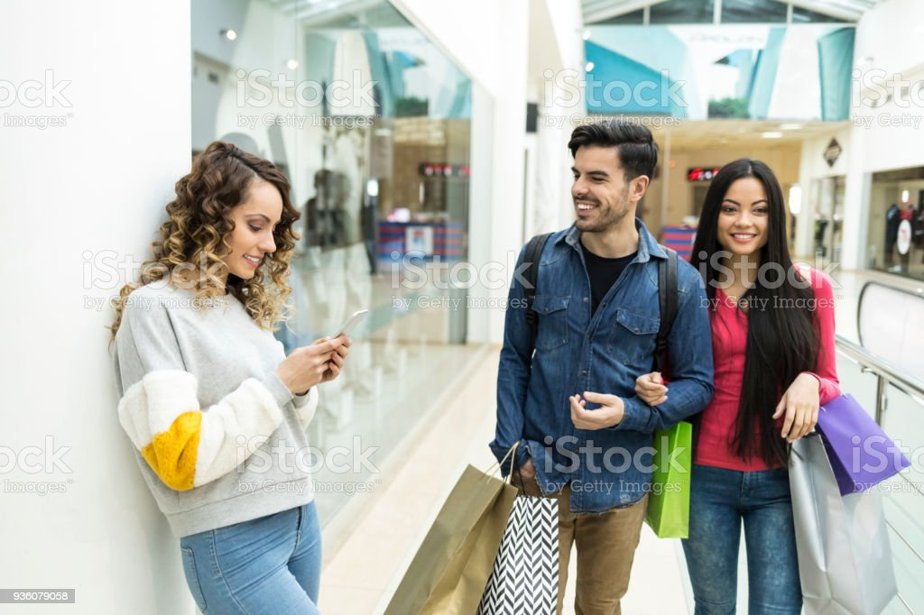 Young people shopping in mall stock photo