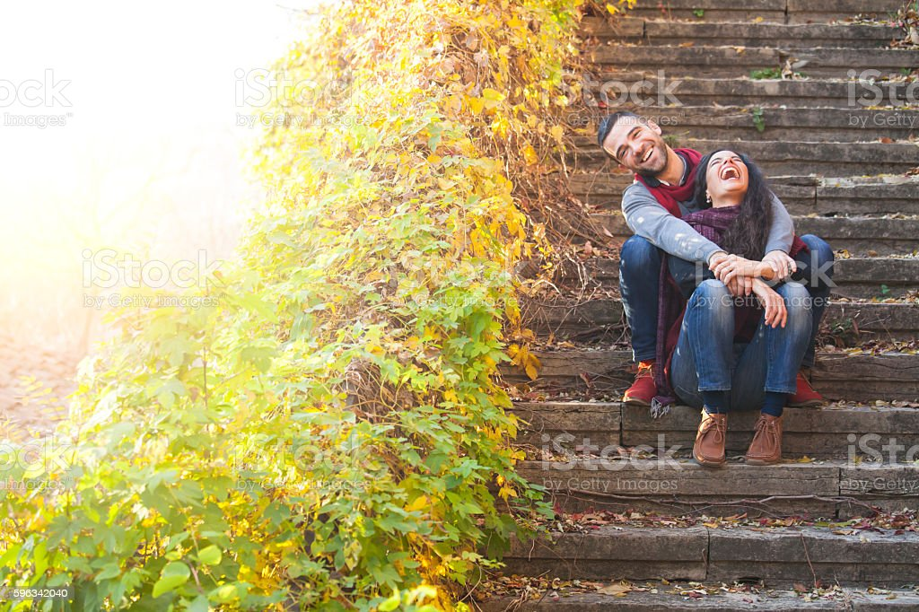 Young people sitting on stairs and having fun royalty-free stock photo