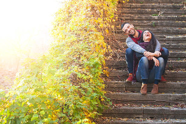 young people sitting on stairs and having fun - september stock photos and pictures