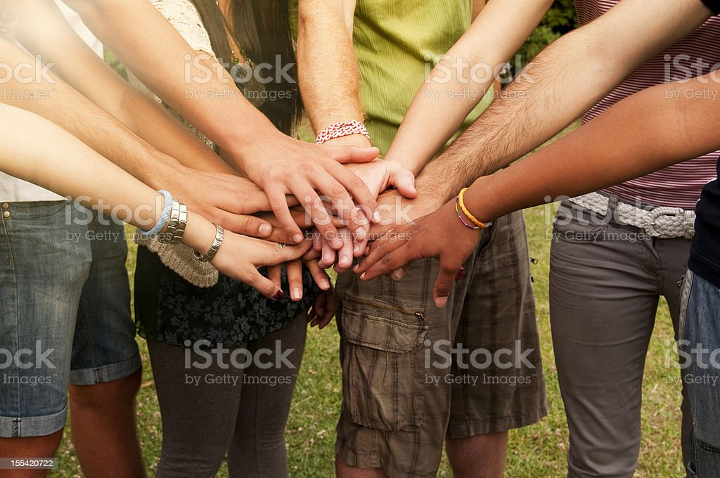 Young People Stack of Hands stock photo