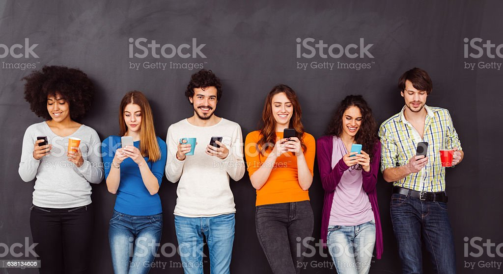 Young people text messaging stock photo