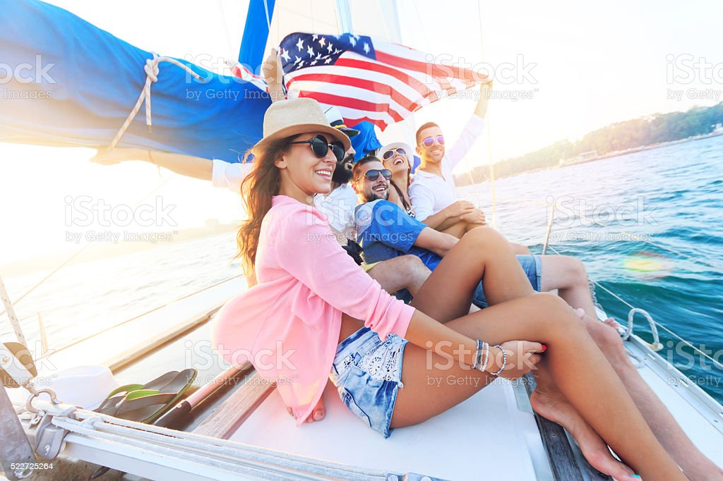 Young people traveling with an yacht stock photo