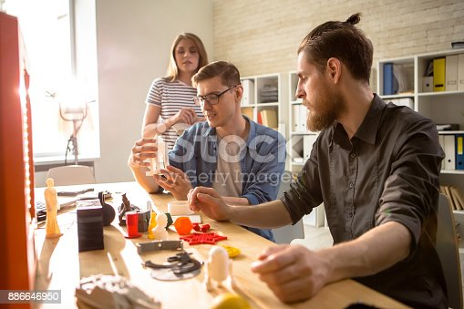886646936 istock photo Young People Using 3D Printer 886646950