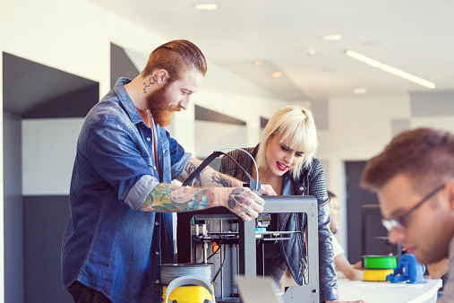 Young People Using A 3d Printer Stock Photo - Download Image Now