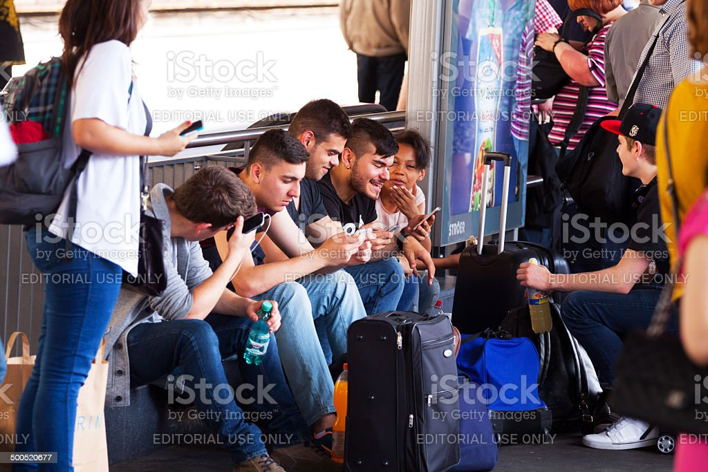 Young people using mobiles stock photo