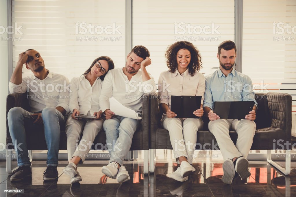 Young people waiting for interview royalty-free stock photo