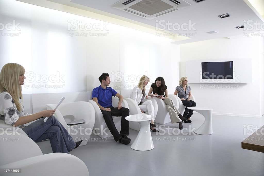 Young people waiting or preparing in the lobby room royalty-free stock photo