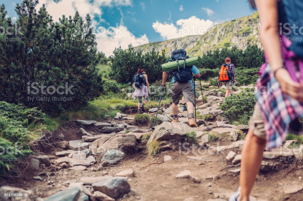 Young people walking in the mountain royalty-free stock photo