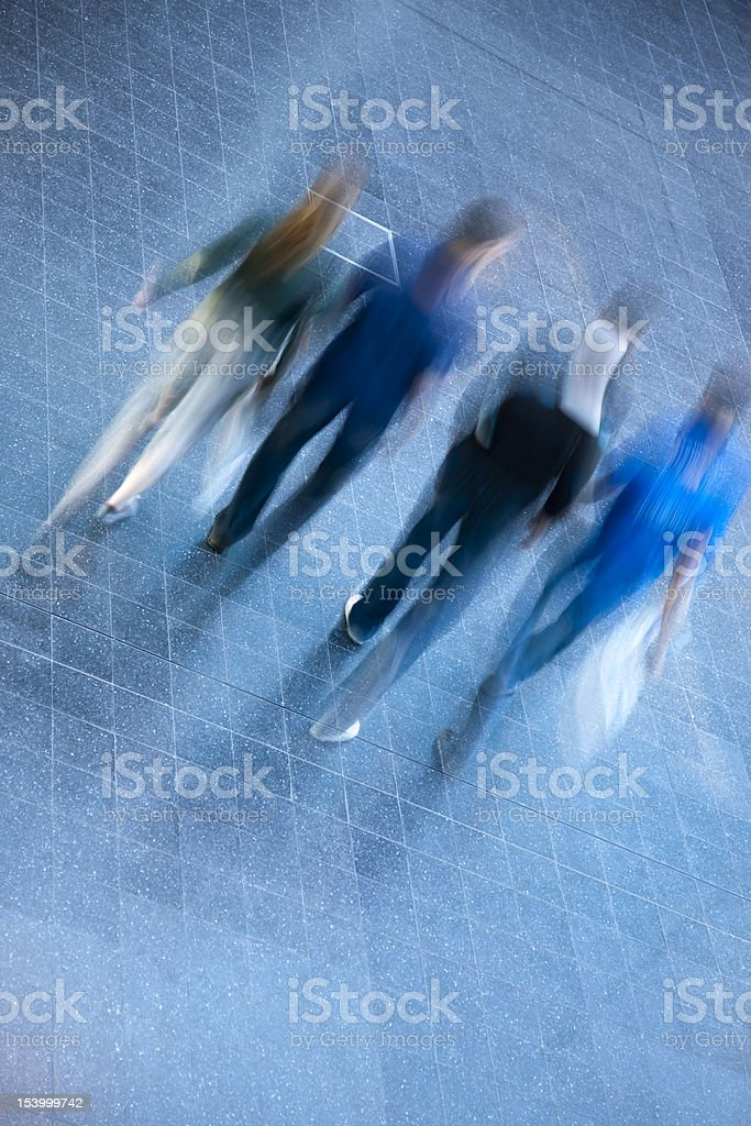 Young People Walking Indoors, Blurred Motion, High Angle View royalty-free stock photo
