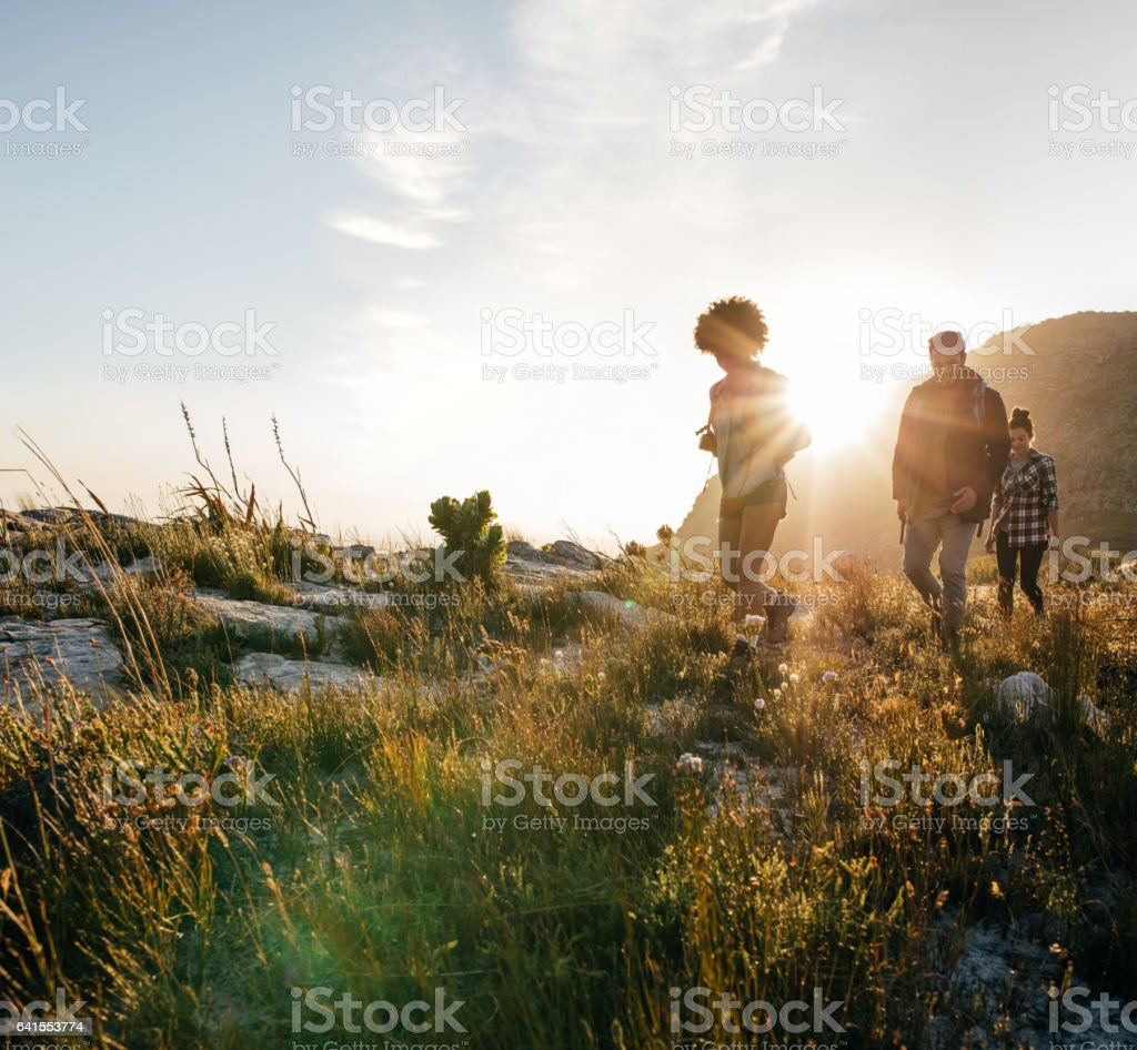 Young people walking through countryside stock photo