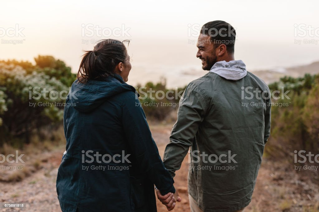 Young people walking through the country path royalty-free stock photo