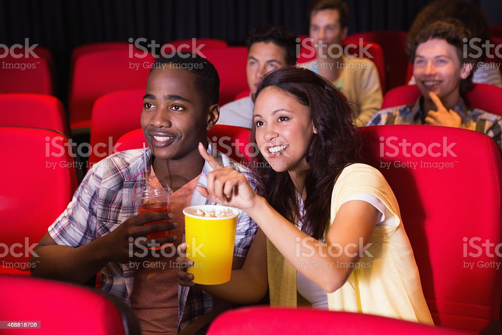 Young people watching a film stock photo